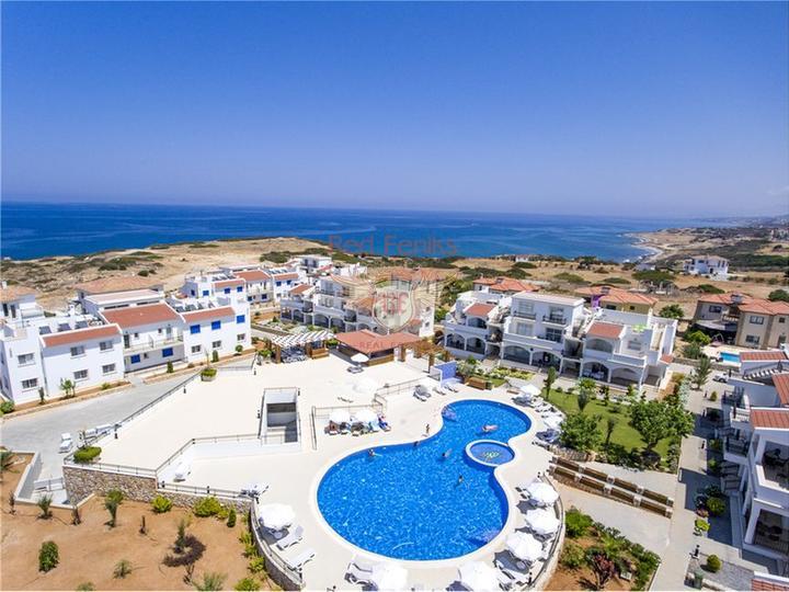 Квартира на первом этаже с 3 спальнями + кухня + общий бассейн + частный пляж, Квартира в Кирения Северный Кипр