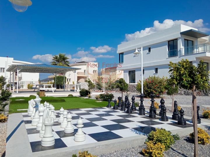 Вилла класса Люкс с 4-мя спальнями + общий бассейн + вид на море и горы + ухоженный двор + недалеко от пляжа, купить дом в Фамагуста
