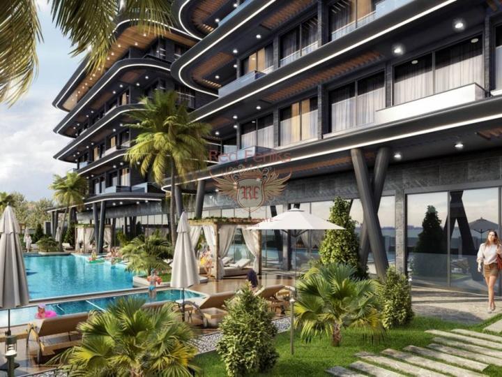 Новые виллы с частными бассейнами в комплексе на первой линии продаются в Адабюкю, Бодрум.