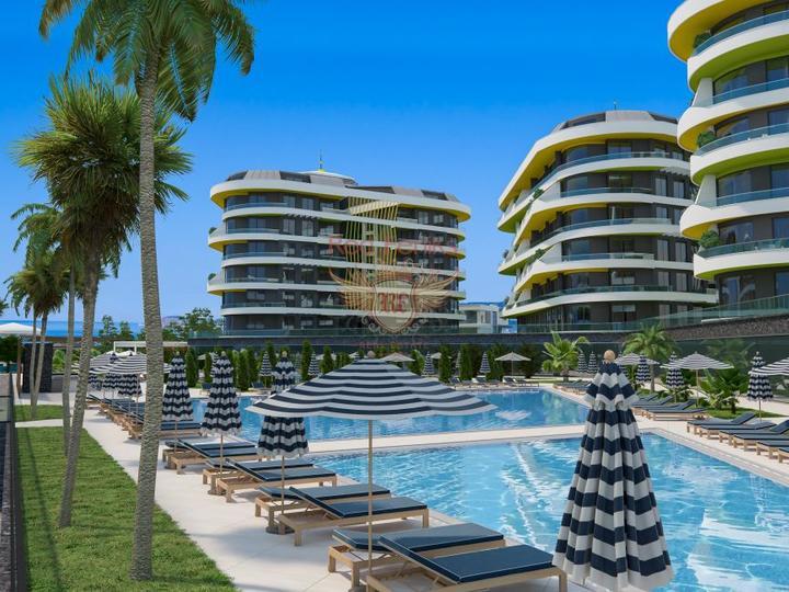 Комплекс состоит из 295 резиденций 1+1, 2+1, 3+1,4+1 и 10 коммерческих помещений на участке площадью 8100 квадратных метров Rooms + Salons Min.