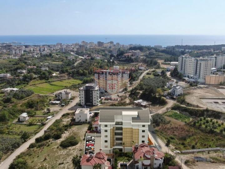 Новый дом под Апарт-Отель в пешей доступности до моря с возможностью получения Турецкого гражданства для всех членов семьи, купить коммерческую недвижимость в Анталия