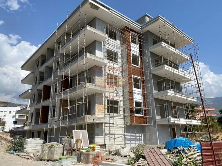 Новый дом под Апарт-Отель в пешей доступности до моря с возможностью получения Турецкого гражданства для всех членов семьи, купить коммерческую в Анталия