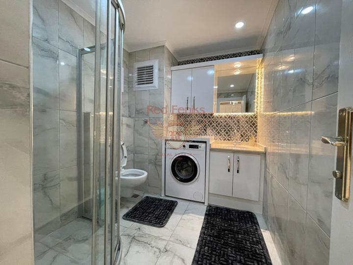 Новая квартира с боковым видом на море, купить квартиру в Алания